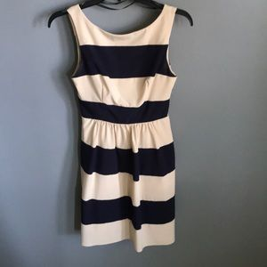 Navy blue and cream colored dress